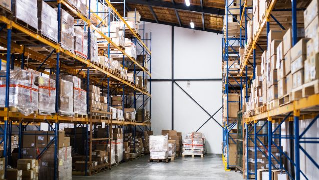 Shelves full of boxes in a warehouse.
